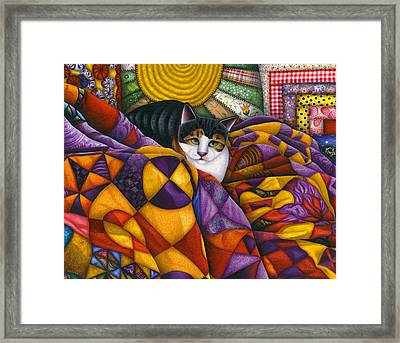 Cat In Quilts Framed Print