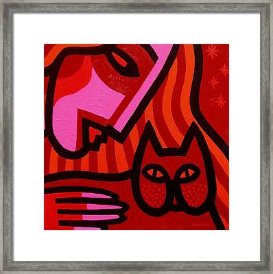 Cat Woman Framed Print by John  Nolan