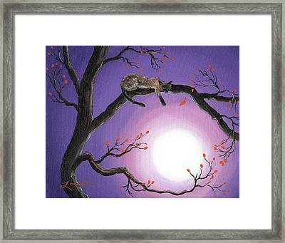 Catch A Falling Leaf Framed Print by Laura Iverson