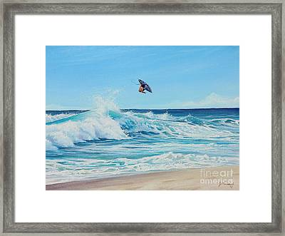 Catching Air Framed Print by Joe Mandrick