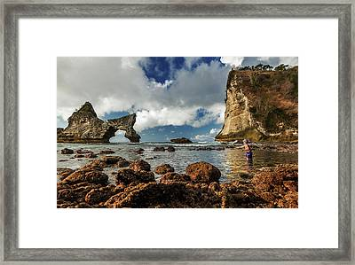 Framed Print featuring the photograph catching fish in Atuh beach by Pradeep Raja Prints