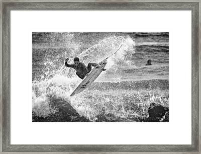 Catching The Board Framed Print