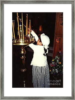 Catherine Lighting Candles Framed Print by Sarah Loft