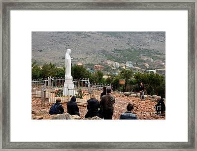 Catholic Pilgrim Worshipers Pray To Virgin Mary Medjugorje Bosnia Herzegovina Framed Print by Imran Ahmed