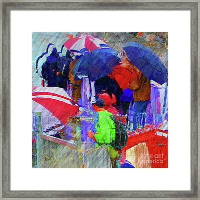 Caught In A Shower Framed Print