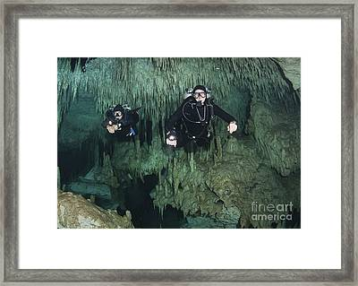 Cave Divers In Dreamgate Cave System Framed Print by Karen Doody