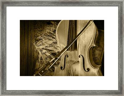 Cello Stringed Instrument With Sheet Music And Bow In Sepia Framed Print