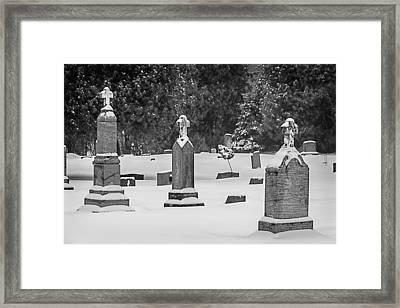 Cemetery In Snow Framed Print by Joan Carroll