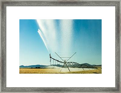 Center Pivot Irrigation Unit Spraying Water Framed Print by Todd Klassy