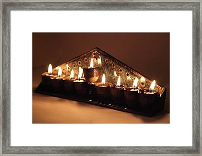 Ceramic Chanukkiah Lit With Eight Lights And One Lighter, The Shamash, Viewed On The Side Framed Print by Yoel Koskas