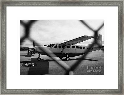 cessna 208B sightseeing tour aircraft at Grand canyon west airport Arizona USA Framed Print by Joe Fox