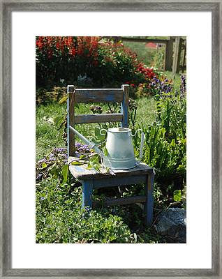 Chair And Watering Can Framed Print by William Thomas