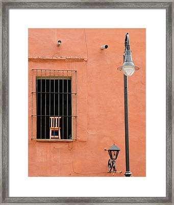 Chair Behind Bars Framed Print by Rob Huntley