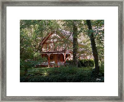 Chalet In The Trees Framed Print by Julie Grace