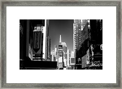 Framed Print featuring the photograph Challenges In Times Square by John Rizzuto