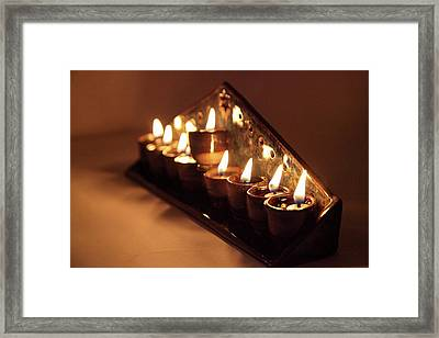 Chanukkiah Lit With Eight Lights And One Lighter, The Shamash, Viewed On The Side Framed Print by Yoel Koskas