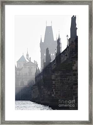 Charles Bridge In The Early Morning Fog Framed Print by Michal Boubin