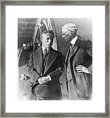 Charlie Chaplin And Henry Ford Framed Print by Underwood Archives