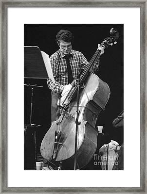 Charlie Haden Takes Care Of His Doublebass Framed Print by Philippe Taka