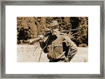Charlton Heston Hunting In Alaska Framed Print by John Malone