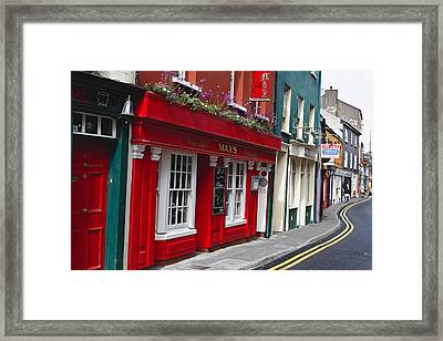 Charming Narrow Street In Kinsale Framed Print by George Oze