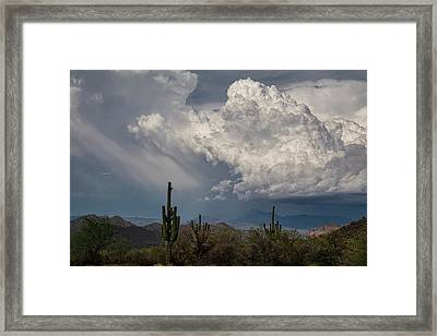 Chasing Clouds As The Rain Falls  Framed Print