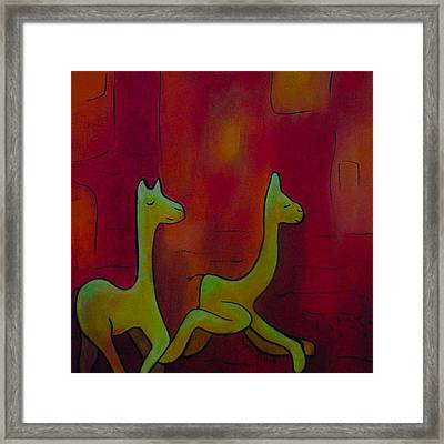 Chasing Llmas Framed Print by Ingrid Russell