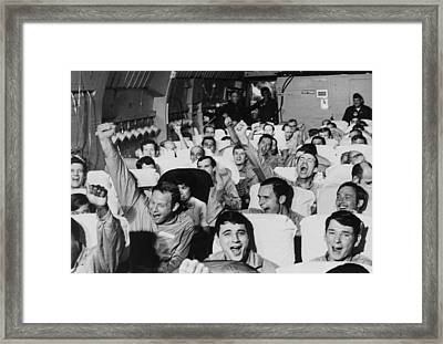 Cheering American Pows. American Framed Print by Everett