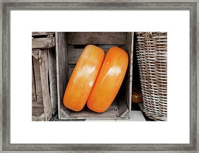 Cheese Wheels Framed Print by Joan Carroll