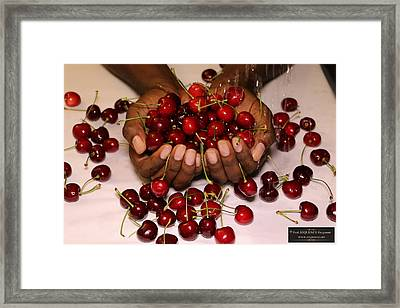 Cherry In The Hands Framed Print