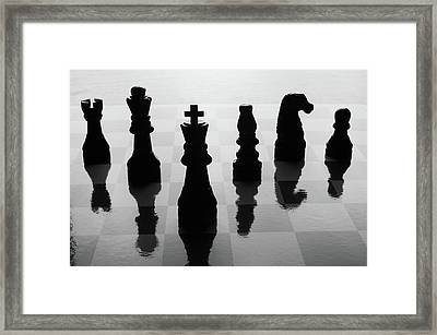 Chess Board And Pieces Framed Print by Jon Schulte