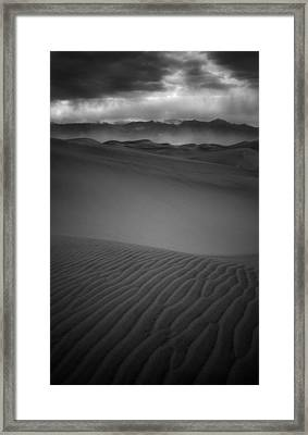 Chewing Sand Framed Print