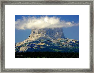 Chief Mountain, With Its Head In The Clouds Framed Print