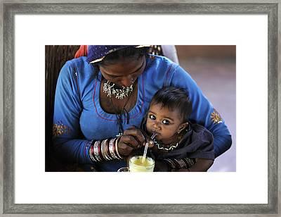 Child Drink Juice Framed Print by Neneo