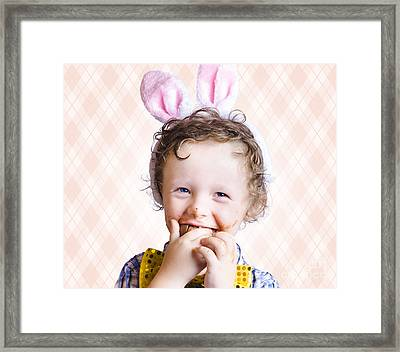 Child Eating Chocolate Easter Egg With Smile Framed Print by Jorgo Photography - Wall Art Gallery