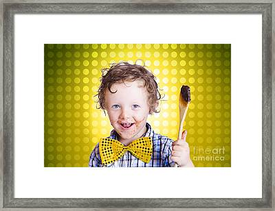 Child Holding Chocolate Covered Cooking Spoon Framed Print by Jorgo Photography - Wall Art Gallery
