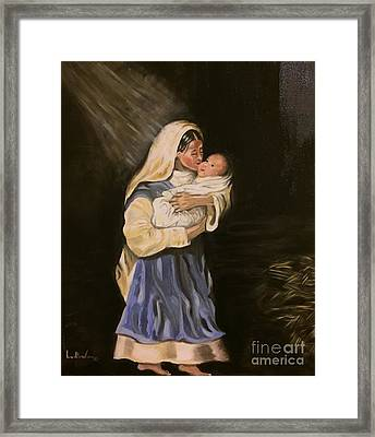 Child In Manger Framed Print