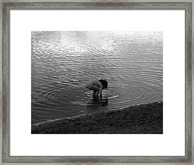 Child Reaching For Treasure Framed Print