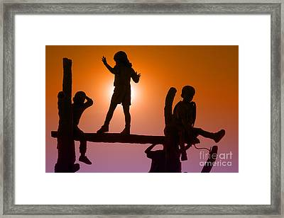 Children Climbing Framed Print by Tim Hightower
