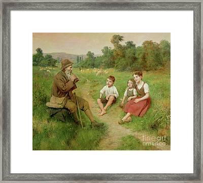 Children Listen To A Shepherd Playing A Flute Framed Print by J Alsina