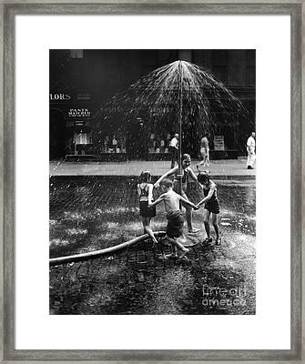 Children Playing In Spray From Hydrant Framed Print by H. Armstrong Roberts/ClassicStock
