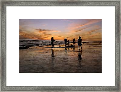 Children Playing On The Beach At Sunset Framed Print by James Forte