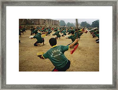 Children Practice Kung Fu In A Field Framed Print by Justin Guariglia