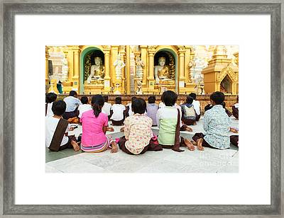 Children Pray At Shwedagon Pagoda Framed Print by Dean Harte