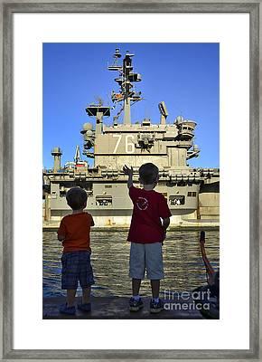 Children Wave As Uss Ronald Reagan Framed Print by Stocktrek Images