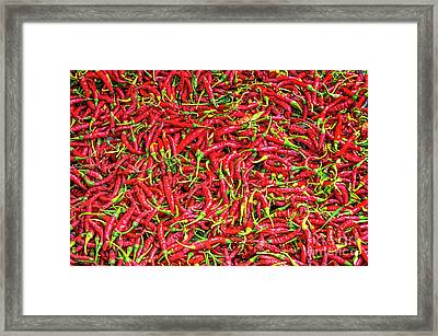 Framed Print featuring the photograph Chillies by Charuhas Images