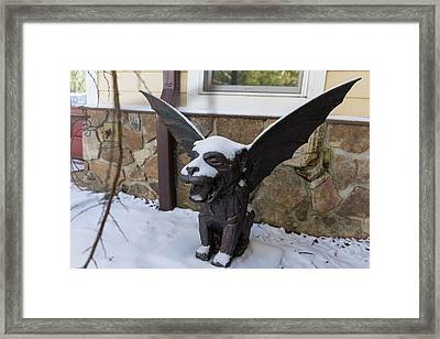 Chimera In The Snow Framed Print