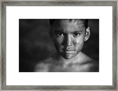Chimneys Boy Framed Print by Miki Meir Levi
