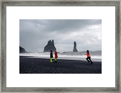 Framed Print featuring the photograph China's Tourists In Reynisfjara Black Sand Beach, Iceland by Dubi Roman