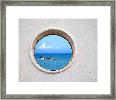 Chinese Fishing Boat Seen Through A Porthole Framed Print